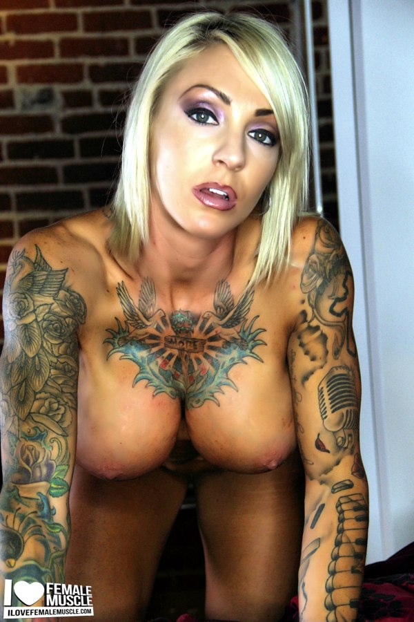 Nude babe fully tattooed something is