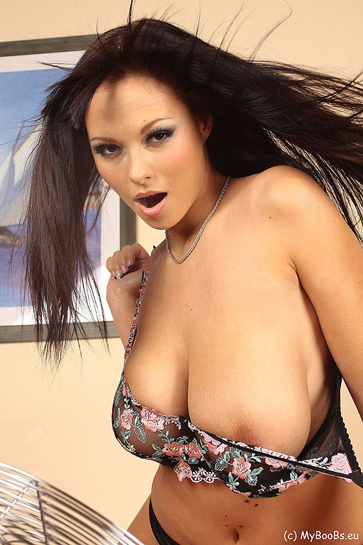 PHOTO | dominno windy 10 - Busty brunette babe Dominno's titties are so big if they catch wind they may knock her out